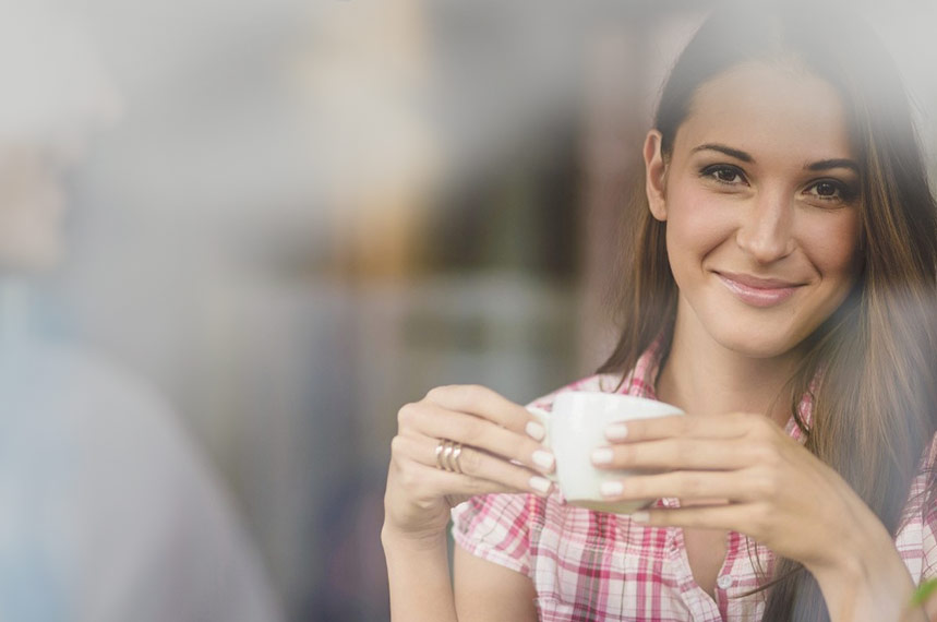 Smiling girl with coffee